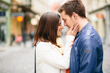 Young woman about to kiss her boyfriend