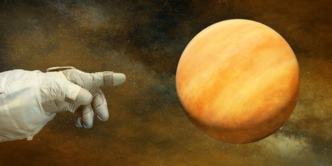 astronaut pointing to the planet Venus in natural colours