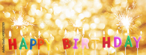 Happy Birthday Candles On Golden Bokeh Light Background With Sparkler