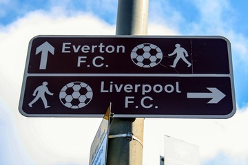A sign explains the direction to Everton and Liverpool Football Club