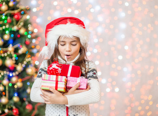 surprised girl holding many present boxes