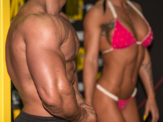 Bodybuilding Concept: Sexy Couple, Muscular Man and Beautiful Athletic Girl