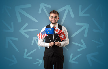 Cheerful boy standing with flag and arrows around