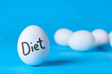 Egg diet for weight loss. Cleaning the body of toxins. Full healthy breakfast. On the egg the word diet, blue background