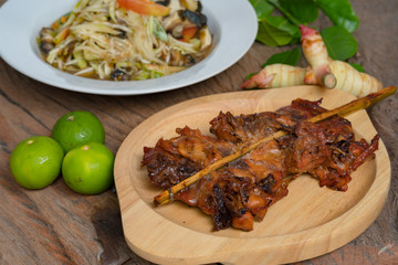 papaya salad grilled chicken and grilled pork thai street food dishes hot and spicy tasty