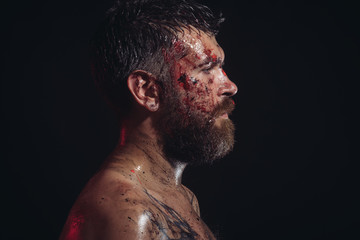 Man with bloody beard on brutal face profile