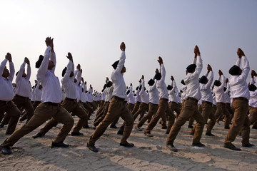 Volunteers of the Hindu nationalist organisation RSS perform yoga during a mega rally in Guwahati