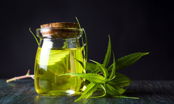Cannabis oil and marijuana leaves