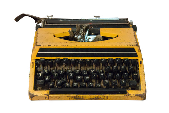 Rusty old vintage yellow typewriter isolated.