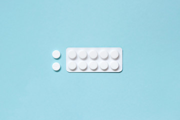 White blister and pills on a blue background. Medications
