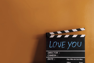 Love you text title on film slate