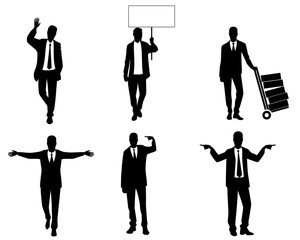 Silhouettes of businessmen in action