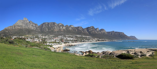 Beautiful Camps Bay in South Africa, with the Twelve Apostles rock formations, as part of Table Mountain.