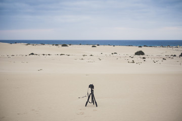 Lonely camera taking landscape picture in the desert