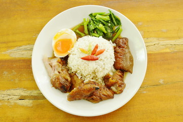 pork trotters stew and boiled egg with rice on plate