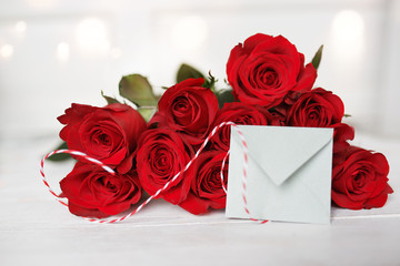Red roses with love letter