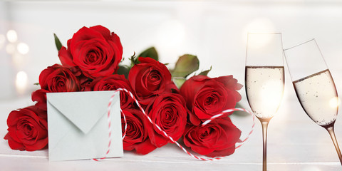 Red roses with champagne and love letter