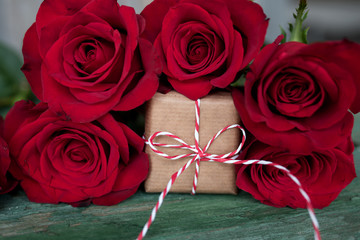 Red roses with a gift for valentines day