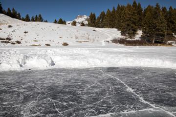 Dark frozen water of a pond ice rink in Colorado
