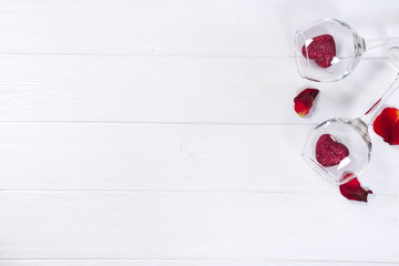 Red hearts in a glasses on wooden background
