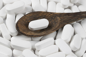 white pills oval shape on a white background