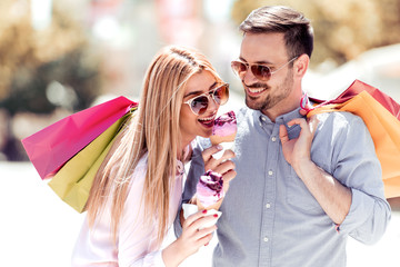 Couple relaxing after shopping,eating ice cream.