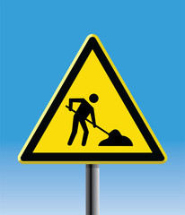 under construction triangular yellow road sign
