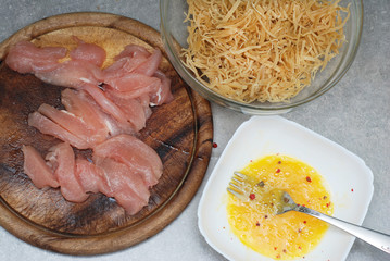 Food Preparing. Raw Chiken Breast Meat and Raw eggs with Homemade Pasta with Spices, s and herbs. Top view