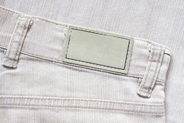Brand label mockup on jeans cloth texture background