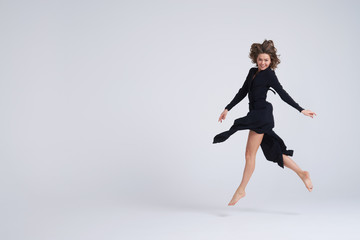 Cheerful beautiful young woman hovering in the air