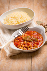 couscous and chickpeas with tomato sauce, selective focus