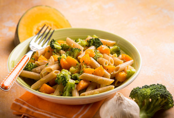 pasta with broccoli and pumpkin, selective focus