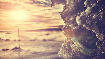 Ice formations at sunset, color toned winter background, shallow depth of field.