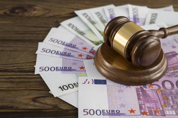 handcuffs with hammer of judge and EURO banknotes money. crime and punishment. court.