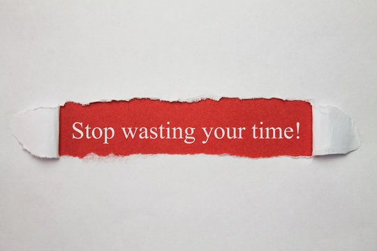 Stop wasting your time word on a torn paper.