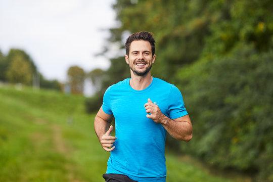 Happy man running in park during summer