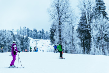 people skiing and snowboarding at winter  mountains