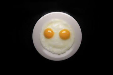 Smiley face made with fried eggs