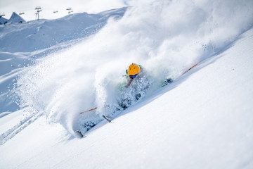 Man skiing in fresh powder snow, Alps, Kitzsteinhorn, Salzburg, Austria