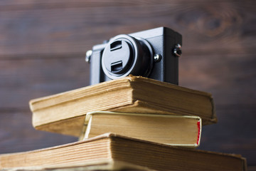 camera on old books