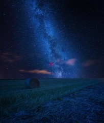 Starry sky over stubble field, fine art landscape