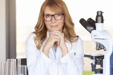 Female scientist sitting in the laboratory