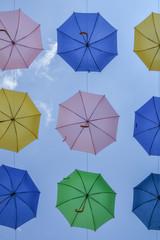 Colored umbrellas in the sky
