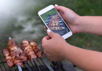 photo of shish kebabs on the phone