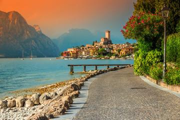 Fantastic Malcesine tourist resort and colorful sunset, Garda lake, Italy Wall mural