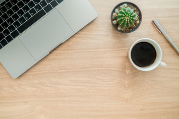 Minimal work space - Creative flat lay photo of workspace desk. Top view office desk with laptop, plant, coffee cup copy space on wooden background. Top view with copy space, flat lay photography.