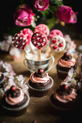 Valentine day background decoration with cup cakes and cake pops,selective focus