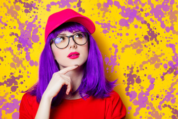 Woman with purple hair and eyeglasses