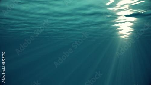 underwater background,Rays of light make their way through ocean
