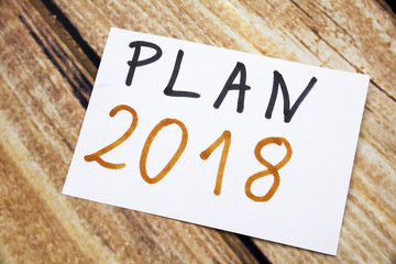 The words Plan 2018 written on a sticky note